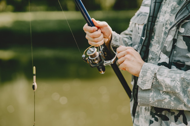 man fishing holds angling rod 1157 38057